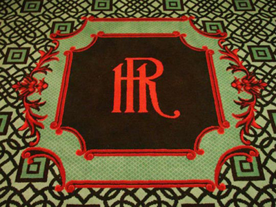 The Hotel Roanoke historic emblem graces the hall carpets.